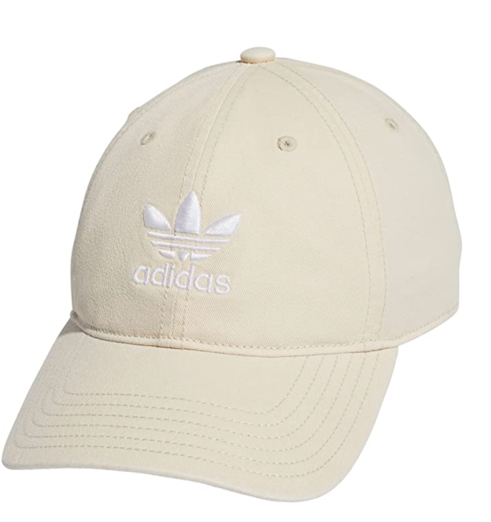 """<p><strong>adidas Originals</strong></p><p>amazon.com</p><p><strong>$25.35</strong></p><p><a href=""""https://www.amazon.com/dp/B01IDSPC7Q?tag=syn-yahoo-20&ascsubtag=%5Bartid%7C2139.g.37612148%5Bsrc%7Cyahoo-us"""" rel=""""nofollow noopener"""" target=""""_blank"""" data-ylk=""""slk:BUY IT HERE"""" class=""""link rapid-noclick-resp"""">BUY IT HERE</a></p><p>Available in several colors, this Adidas hat goes with absolutely everything. It's truly no wonder it's an Amazon Choice product. For the neutral, minimal style lover, pick it up in black, white, or tan.</p>"""