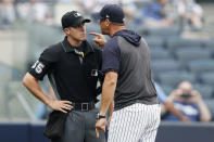 FILE - In this Thursday, July 18, 2019, file photo, New York Yankees' manager Aaron Boone yells at home plate umpire Brennan Miller during the second inning of the first game of a baseball doubleheader against the Tampa Bay Rays in New York. The Rays and Yankees will play in the American League Division Series beginning Monday, Oct. 5, 2020.(AP Photo/Kathy Willens, File)