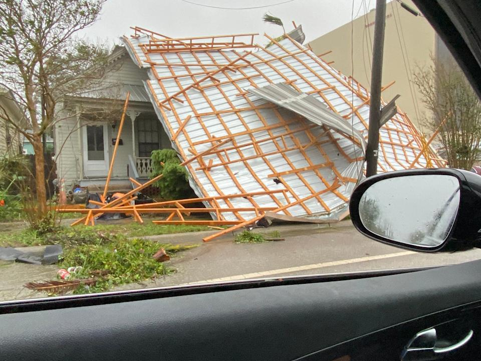 The roof of a house on Alcaniz Street has blown off after Hurricane Sally swept through the area on Sept. 16, 2020.