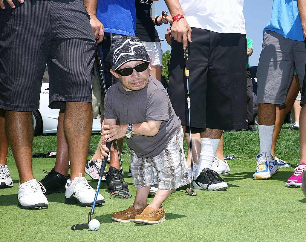 "Verne ""Mini-Me"" Troyer lines up a putt. Please, no miniature golf jokes! Tiffany Rose/<a href=""http://www.wireimage.com"" target=""new"">WireImage.com</a> - July 27, 2009"