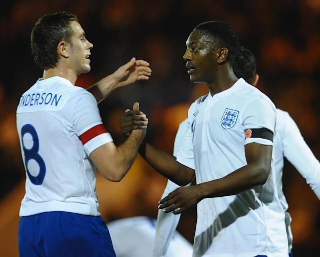 COLCHESTER, ENGLAND - NOVEMBER 10: Marvin Sordell of England is congratulated on scoring the opening goal by Jordan Henderson during the UEFA Under-21 Championship Group 8 Qualifier between England and Iceland at the Weston Homes Community Stadium on November 10, 2011 in Colchester, England. (Photo by Laurence Griffiths/Getty Images)