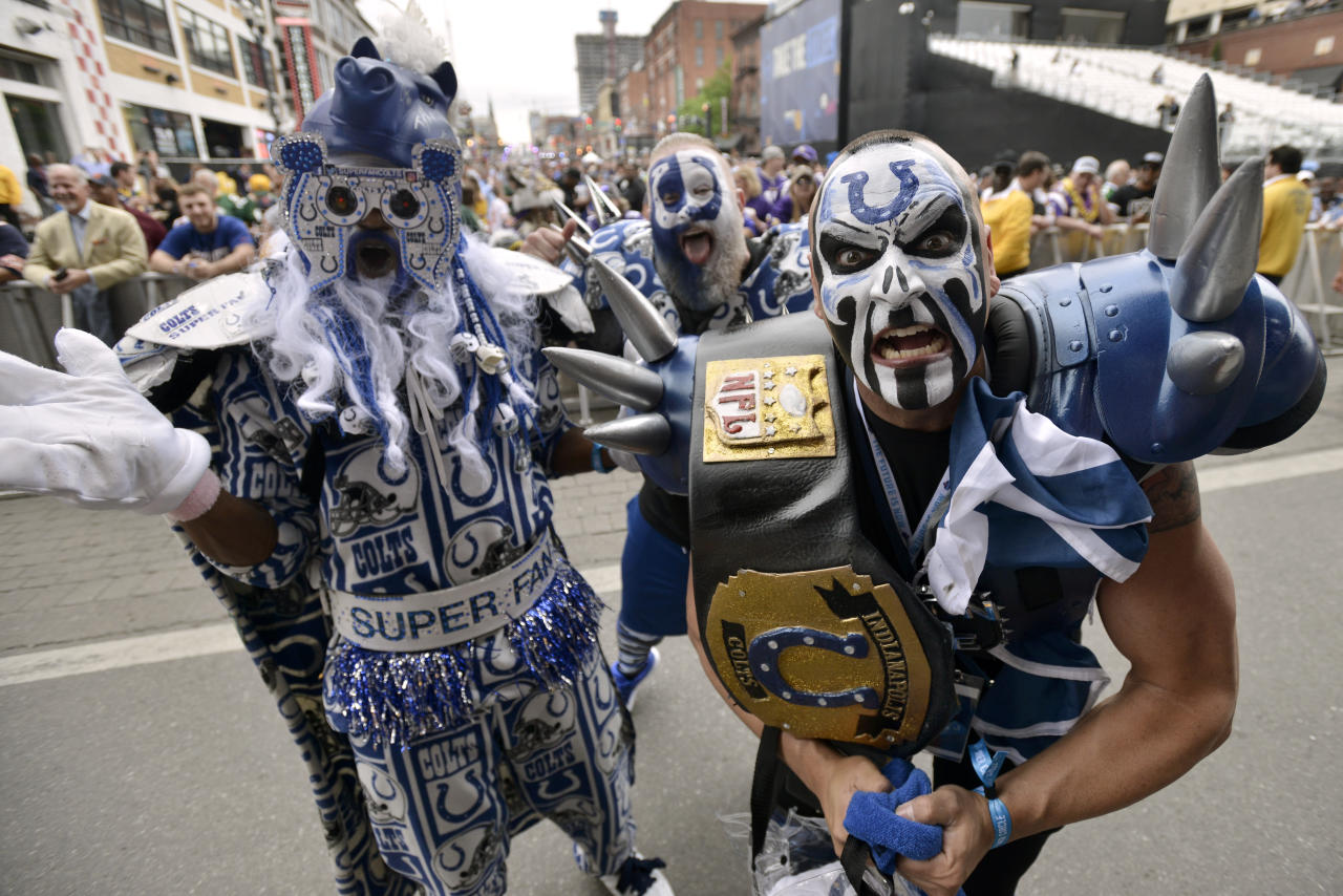 Indianapolis Colts fans pose for a photo during the 2019 NFL Draft Thursday, Apr. 25, 2019, in Nashville, Tenn. (AP Photo/Brandon Dill)