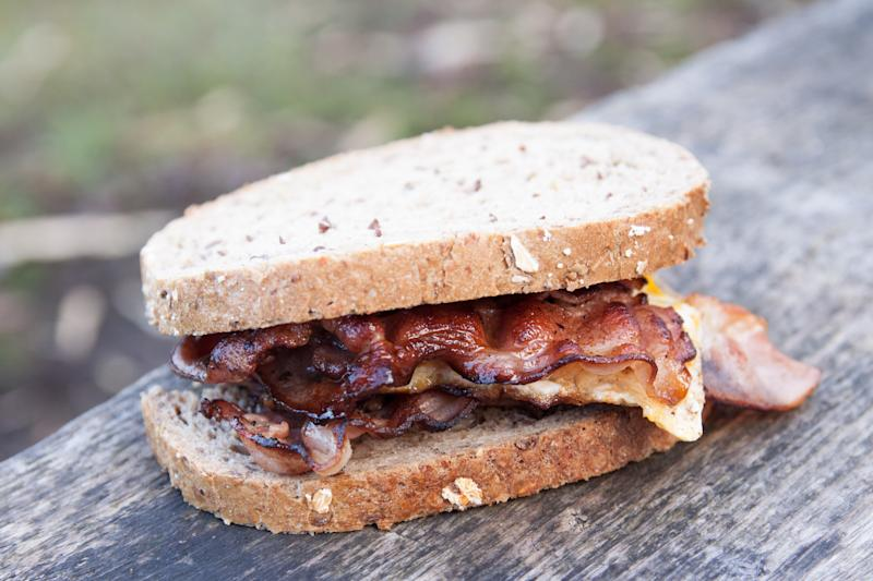 Just one or two portions of processed meat like bacon sandwiches a week could increase the risk of heart attack [Photo: Getty]