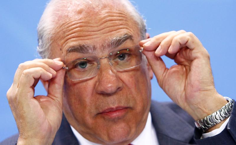 Jose Angel Gurria, Secretary-General of the Organisation for Economic Co-operation and Development (OECD) adjusts his glasses as he attends a news conference with representatives of the trade organizations after a meeting in the chancellery in Berlin, Germany, June 11, 2018. REUTERS/Michele Tantussi