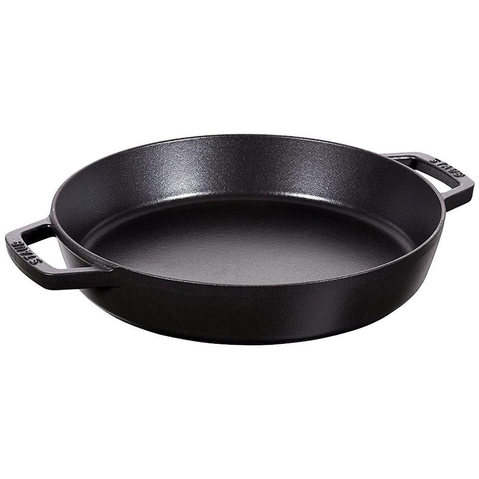 """<p><strong>Staub</strong></p><p>amazon.com</p><p><strong>$259.95</strong></p><p><a href=""""https://www.amazon.com/dp/B00PMVQY2A?tag=syn-yahoo-20&ascsubtag=%5Bartid%7C2141.g.33485335%5Bsrc%7Cyahoo-us"""" rel=""""nofollow noopener"""" target=""""_blank"""" data-ylk=""""slk:Shop Now"""" class=""""link rapid-noclick-resp"""">Shop Now</a></p><p>The Cadillac of cast iron skillets, this extra deep Staub pick is for you if Thanksgiving is always at your house or you're shopping for a wedding gift with money to spare. At <strong>16.22 x 13.86 x 2.36 inches, it can roast a turkey</strong> (it's oven-safe up to 900°F) and show it off as a serving tray. Order it in matte black (shown) or rich cherry; both are dishwasher safe. </p>"""