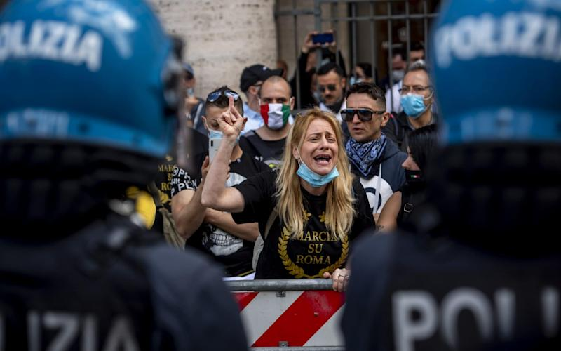 Protestors gathered in Rome to express their anger at the Italian government's response to the economic crisis caused by the novel coronavirus pandemic - Antonio Masiello/Getty Images Europe