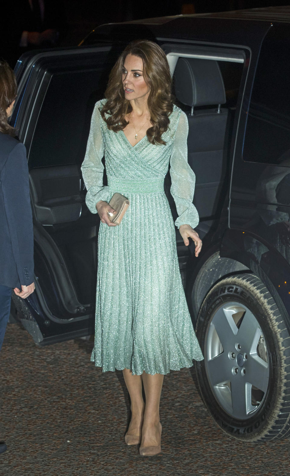 At Belfast's Empire Music Hall, Kate looked flawless in a mint green lamé dress by Missoni, with her Gianvito Rossi pumps in the praline colourway and her nude Mulberry Bayswater clutch bag. She accessorised with new jewellery from Kiki McDonough's 'Candy' collection. [Photo: PA]