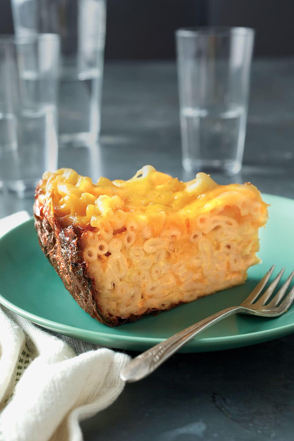 """<p><strong>Recipe: <a href=""""https://www.southernliving.com/syndication/uncle-jacks-mac-cheese"""" rel=""""nofollow noopener"""" target=""""_blank"""" data-ylk=""""slk:Uncle Jack's Mac-and-Cheese"""" class=""""link rapid-noclick-resp"""">Uncle Jack's Mac-and-Cheese</a></strong></p> <p>Classic cafeteria-style goodness, this recipe yields enough to serve as a side for a crowd, or it could be dinner for a family of four. Recipe by Pam Rawlinson, North Augusta, South Carolina.</p>"""