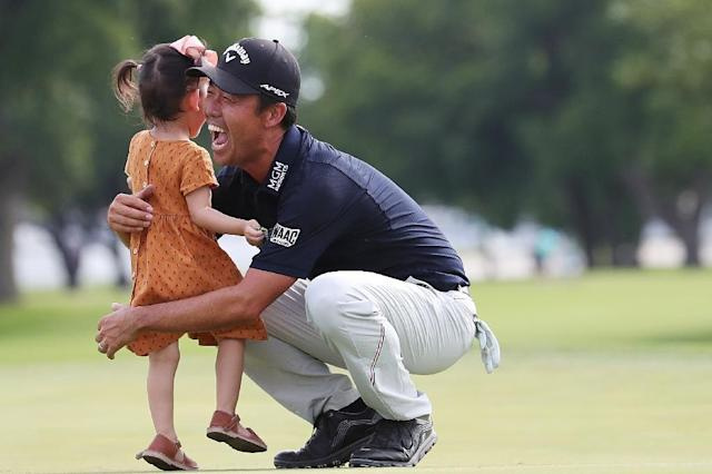 South Korea-born American Kevin Na celebrates with his daughter, Sophia, after winning his third US PGA Tour title in the Charles Schwab Challenge at Colonial Country Club in Fort Worth, Texas (AFP Photo/TOM PENNINGTON)
