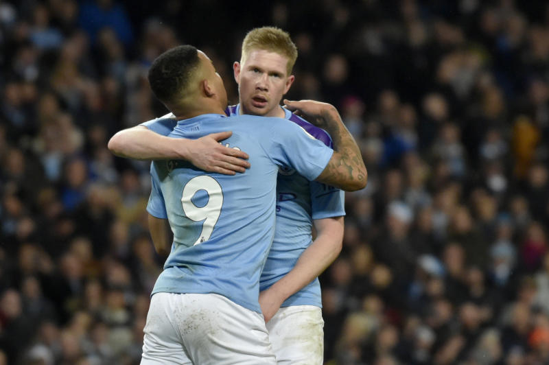 Manchester City's Gabriel Jesus, left, celebrates with Kevin De Bruyne after scoring his side's third goal during the English Premier League soccer match between Manchester City and Leicester City at Etihad stadium in Manchester, England, Saturday, Dec. 21, 2019. (AP Photo/Rui Vieira)