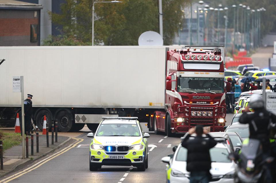 The container lorry where 39 people were found dead inside leaves Waterglade Industrial Park in Grays, Essex, heading towards Tilbury Docks under police escort.