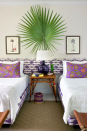 """<p>Take inspiration from your last beach getaway and decorate your bedside table with a palm leaf plant. If you really want to stay on theme, hang a pair of framed palm tree prints on either side. </p><p><b>RELATED: </b><a href=""""https://www.goodhousekeeping.com/home/gardening/advice/g1285/hard-to-kill-plants/"""" rel=""""nofollow noopener"""" target=""""_blank"""" data-ylk=""""slk:25 Gorgeous Indoor Plants That Are Almost Impossible to Kill"""" class=""""link rapid-noclick-resp"""">25 Gorgeous Indoor Plants That Are Almost Impossible to Kill</a></p>"""
