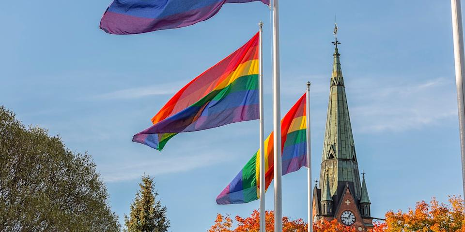 rainbow flag in front of church