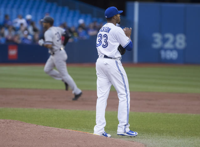 Toronto Blue Jays pitcher Edwin Jackson walks off the mound after giving up three-run home run to New York Yankees' Aaron Hicks, left, during the second inning of a baseball game Thursday, June 6, 2019, in Toronto. (Fred Thornhill/The Canadian Press via AP)