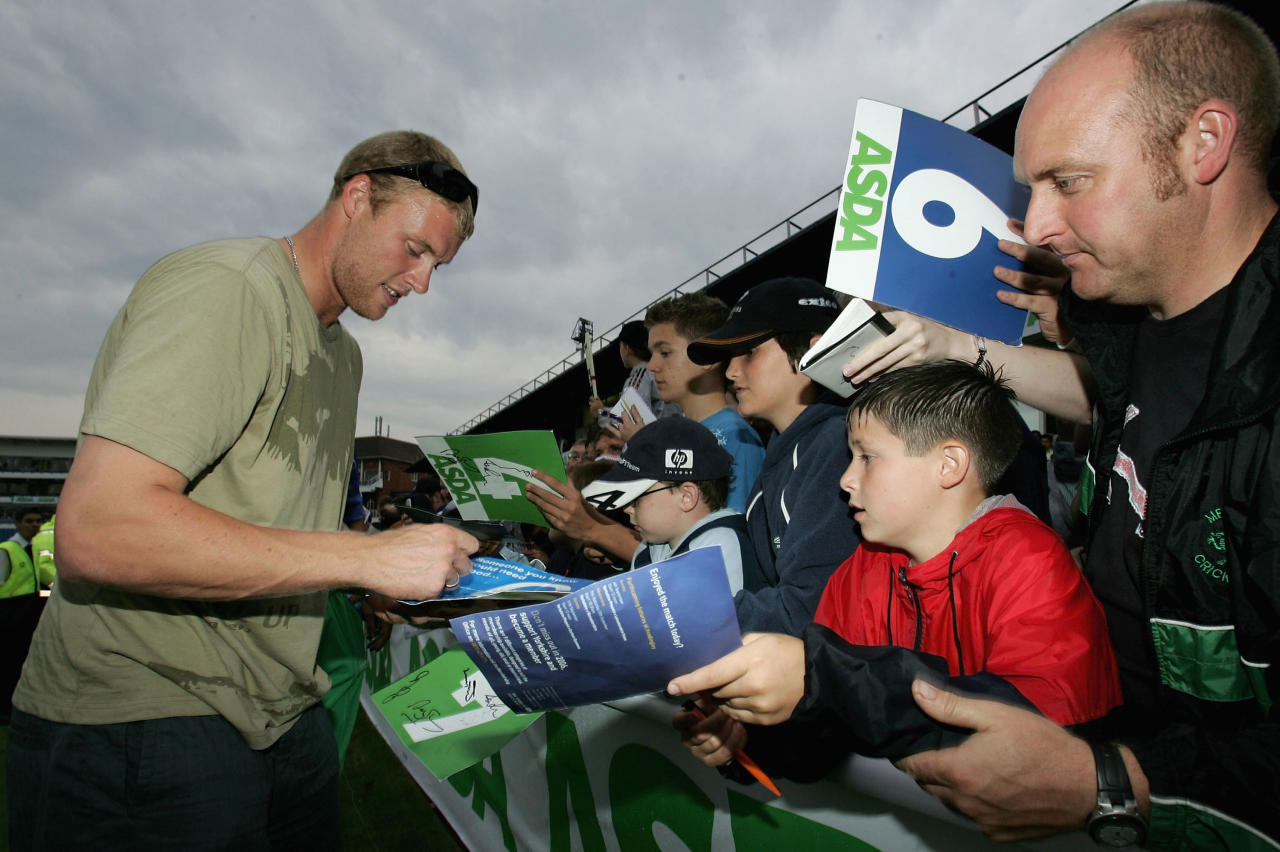 LEEDS, ENGLAND - AUGUST 31:  Andrew Flintoff of Lancashire and England signs autographs during the Adsa Challenge Twenty20between Michael Vaughans XI and a Yorkshire XI at Headingley on August 31 2005 in Leeds, England.  (Photo by Tom Shaw/Getty Images)