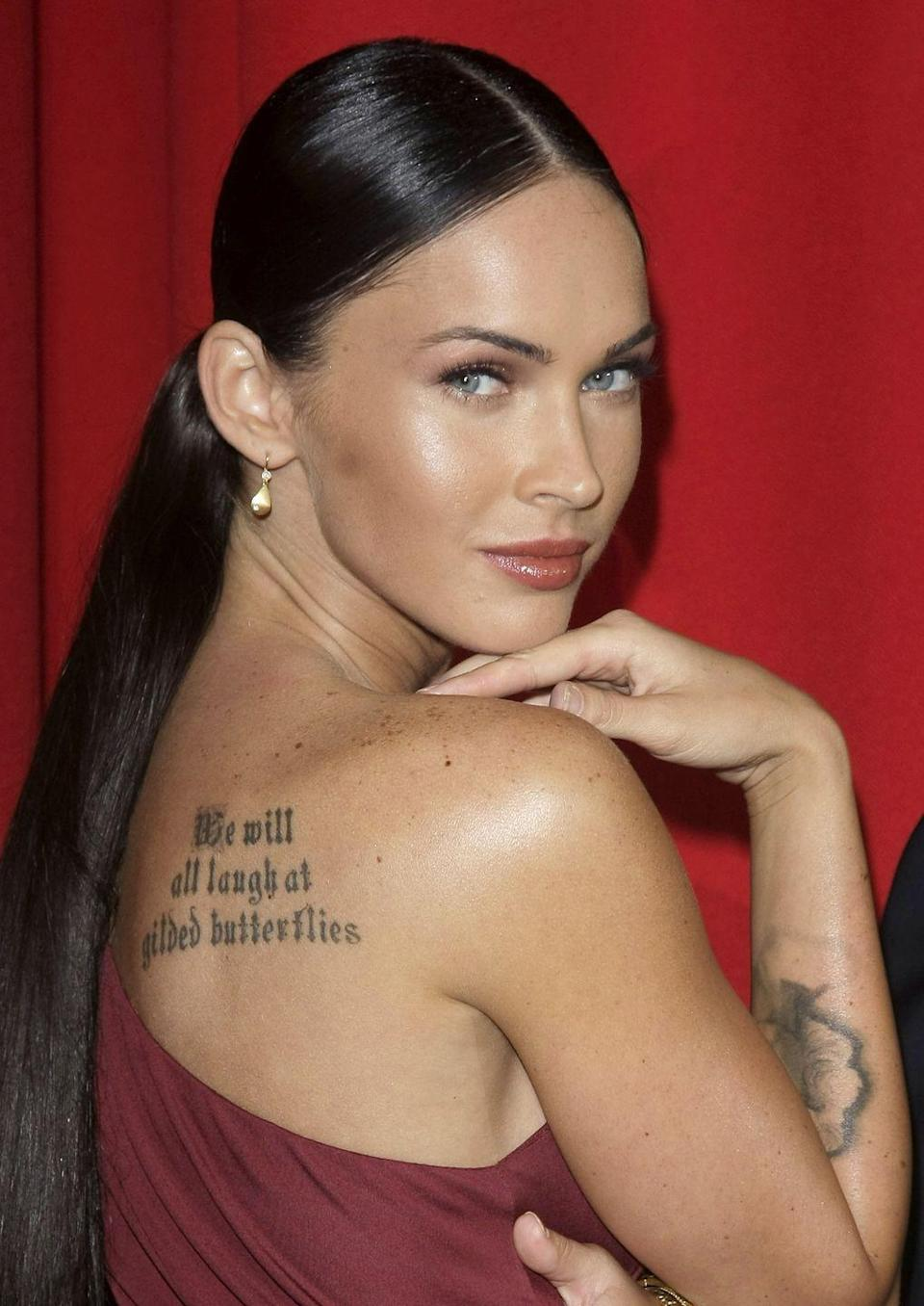 """<p>Megan Fox's love for Marilyn Monroe runs deeps—but not deep enough to keep her tattoo of the blonde bombshell on her forearm. <em><a href=""""https://www.marieclaire.co.uk/news/celebrity-news/megan-fox-removes-negative-marilyn-monroe-tattoo-164144"""" rel=""""nofollow noopener"""" target=""""_blank"""" data-ylk=""""slk:Marie Claire"""" class=""""link rapid-noclick-resp"""">Marie Claire</a></em> reports that the actress first got the tat because Marilyn was one of the first people she saw on television and that Megan """"always empathized with her."""" But later, the <em>Jennifer's Body</em> star realized Marilyn's life wasn't maybe wasn't one she wanted to emulate. </p><p>""""She was a negative person, she was disturbed, bipolar,"""" she said. """"I do not want to attract this kind of negative energy in my life.""""</p>"""