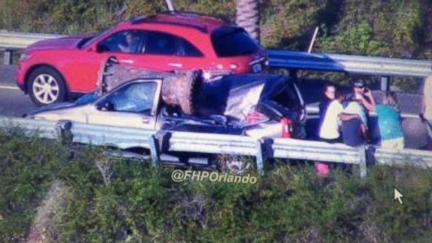 PHOTO: A man survived after a large piece of scrap metal fell from a truck that lost control and overturned on a highway, crushing his vehicle under the overpass, Orange County, Fla., July 15, 2017. (Courtesy Florida Highway Patrol)