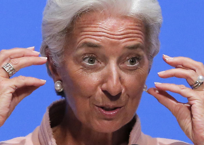 IMF Managing Director Christine Lagarde speaks at a forum for the annual meetings of the IMF and World Bank Group at a Tokyo hotel Friday, July 6, 2012. Lagarde has praise for Japan's move to raise its sales tax to curb the swollen national debt. (AP Photo/Itsuo Inouye)