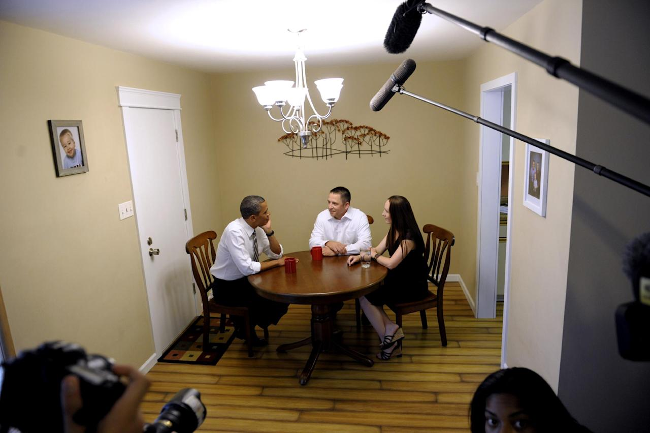 President Barack Obama talks with Jason and Ali McLaughlin while visiting their home in Cedar Rapids, Iowa, Tuesday, July 10, 2012. (AP Photo/Susan Walsh)
