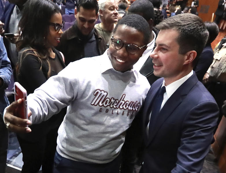 Morehouse College student Keron Campbell snaps a selfie with presidential hopeful Pete Buttigieg, Mayor of South Bend, Ind., at Morehouse College on Monday, Nov. 18, 2019, in Atlanta. (Curtis Compton/Atlanta Journal-Constitution via AP)