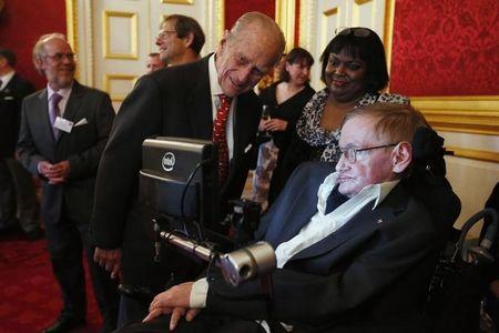 Britain's Prince Philip meets Hawking during a reception for Leonard Cheshire Disability charity at St James's Palace in London
