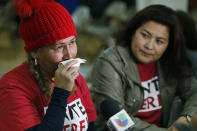 <p>El Salvador immigrants Diana Paredes, left, and Isabel Barrera, react at a news conference following an announcement on Temporary Protected Status for nationals of El Salvador, in Los Angeles, Monday Jan. 8, 2018. (Photo: Damian Dovarganes/AP) </p>