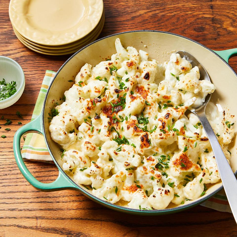 "<p>We replaced pasta with cauliflower in this creamy low-carb ""mac"" and cheese. A sprinkle of Parmesan on top and a quick trip under the broiler gives this cheesy side dish a savory, crispy crust.</p>"