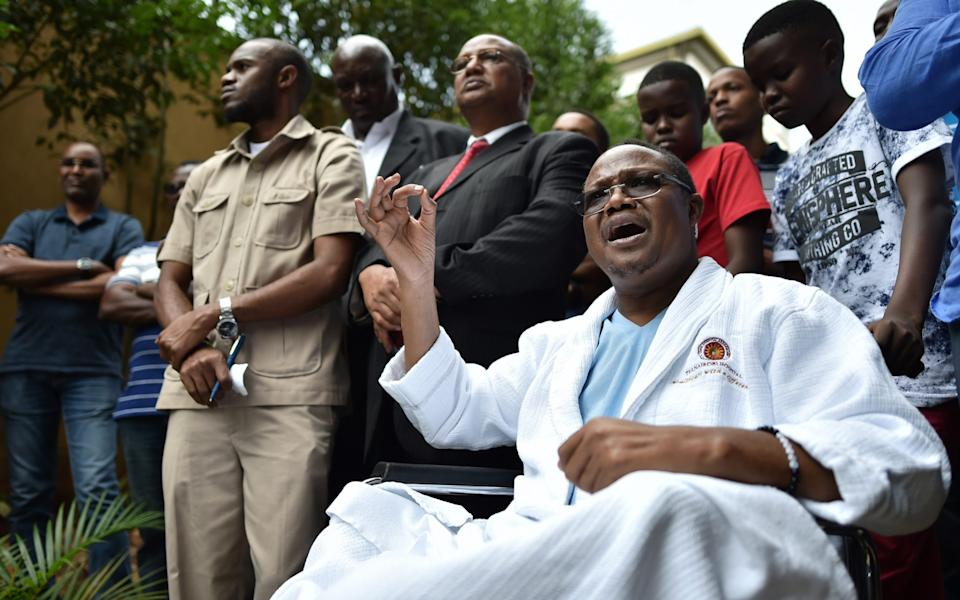 Tanzanian main opposition chief Tundu Lissu gestures from his wheelchair on January 5, 2018 in Nairobi, after he was shot 16 times by unknown gunmen with Kalashikovs. - TONY KARUMBA/AFP via Getty Images