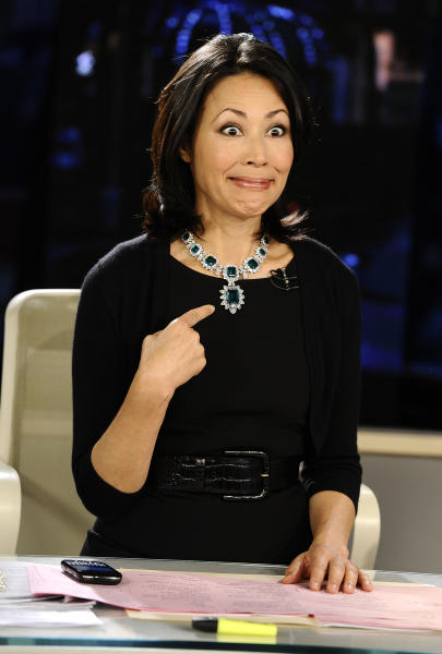"This Sept. 7, 2011 photo released by NBC shows co-host Ann Curry modeling one of Elizabeth Taylor's necklaces, which was auctioned by Christie's, on the ""Today"" show in New York. Curry offered a tearful goodbye as co-host of NBC's ""Today"" show on Thursday, June 28, 2012. Curry, who joined the show as a news anchor in 1997, will remain at NBC News to be anchor-at-large and national and international correspondent. (AP Photo/NBC, Peter Kramer)"