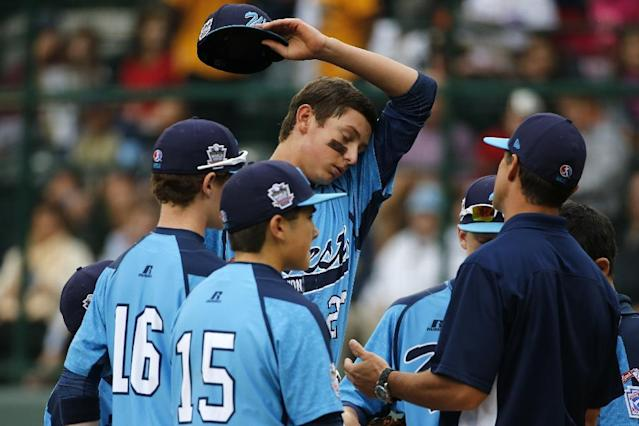 Las Vegas pitcher Brennan Holligan collects himself on the mound in the second inning of the United States Championship game against Chicago at the Little League World Series tournament in South Williamsport, Pa., Saturday, Aug. 23, 2014. Chicago won 7-5. (AP Photo/Gene J. Puskar)