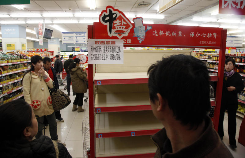 Shoppers look at empty shelves for salt at a supermarket in Beijing, China, Thursday, March 17, 2011. Worried shoppers stripped stores of salt in Beijing, Shanghai and other parts of China on Thursday in the false belief it can guard against radiation exposure. (AP Photo/Ng Han Guan)