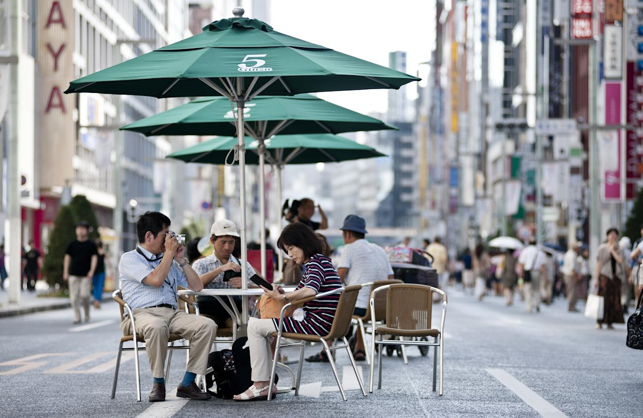 TOKYO, JAPAN - AUGUST 31: People enjoy their afternoon in Ginza shopping district on August 31, 2013 in Tokyo, Japan. Ginza is recognized as one of the most luxurious shopping districts in the world and streets are closed to traffic on weekends. Along with Istanbul and Madrid, Tokyo is one of the candidate cities bidding to host the 2020 Summer Olympic Games. The International Olympic Committee (IOC) is due to elect the host city during the 125th IOC Session on September 7, 2013 in Buenos Aires, Argentina. (Photo by Keith Tsuji/Getty Images)