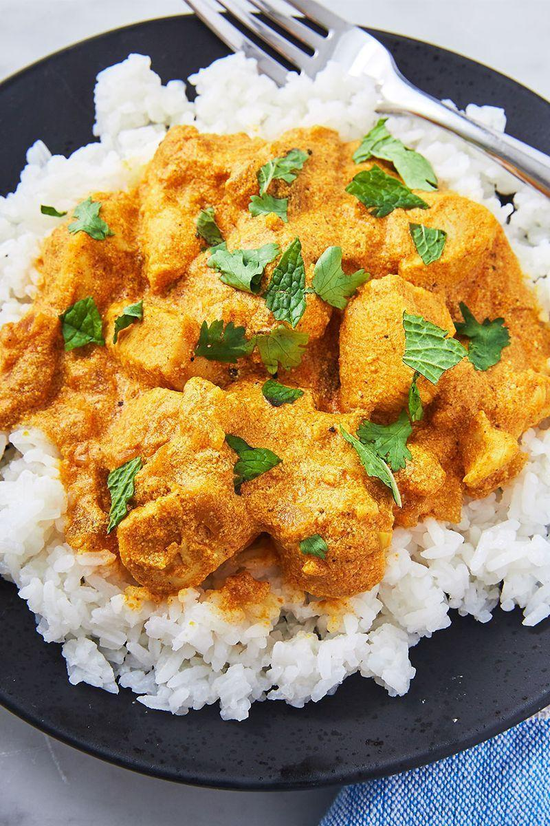 """<p>This quick and easy coconut curry might be a bit untraditional, but trust us, it's delicious. Don't forget to whip up some rice to soak up all that saucy goodness. Check out our step-to-step guide on <a href=""""https://www.delish.com/uk/food-news/a28997170/how-to-cook-rice/"""" rel=""""nofollow noopener"""" target=""""_blank"""" data-ylk=""""slk:how to cook rice"""" class=""""link rapid-noclick-resp"""">how to cook rice</a> for the fluffiest rice ever. (Catch ya later, dry takeaway rice!)</p><p>Get the <a href=""""https://www.delish.com/uk/cooking/recipes/a30165274/easy-coconut-curry-chicken-recipe/"""" rel=""""nofollow noopener"""" target=""""_blank"""" data-ylk=""""slk:Coconut Chicken Curry"""" class=""""link rapid-noclick-resp"""">Coconut Chicken Curry</a> recipe.</p>"""