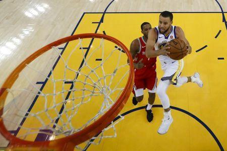 May 26, 2018; Oakland, CA, USA; Golden State Warriors guard Stephen Curry (30) drives to the basket against Houston Rockets forward Trevor Ariza (1) during the first half in game six of the Western conference finals of the 2018 NBA Playoffs at Oracle Arena. Mandatory Credit: John G. Mabanglo/Pool Photo via USA TODAY Sports