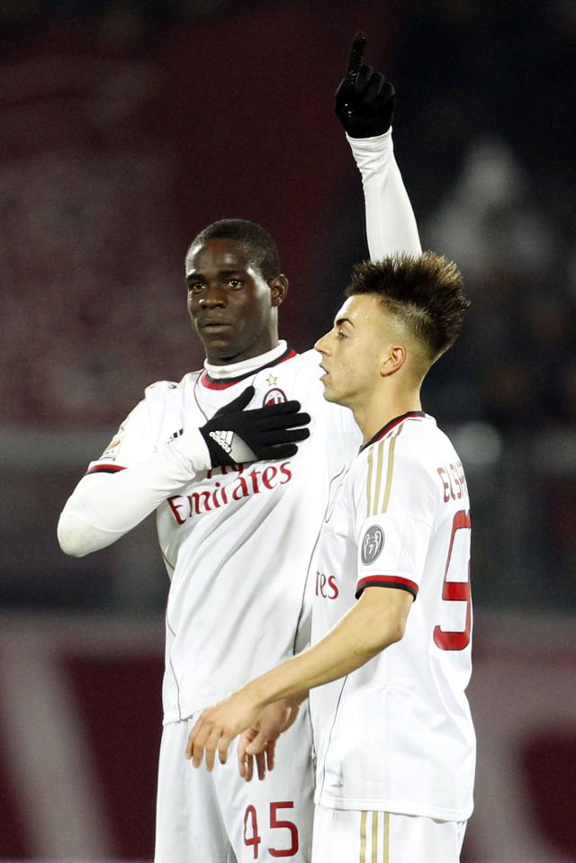 AC Milan's Mario Balotelli (L) celebrates next his teammate Stephan El Shaarawy after scoring his second goal against Livorno during their Italian Serie A soccer match at the Armando Picchi stadium in Livorno December 7, 2013. REUTERS/Giampiero Sposito (ITALY - Tags: SPORT SOCCER)