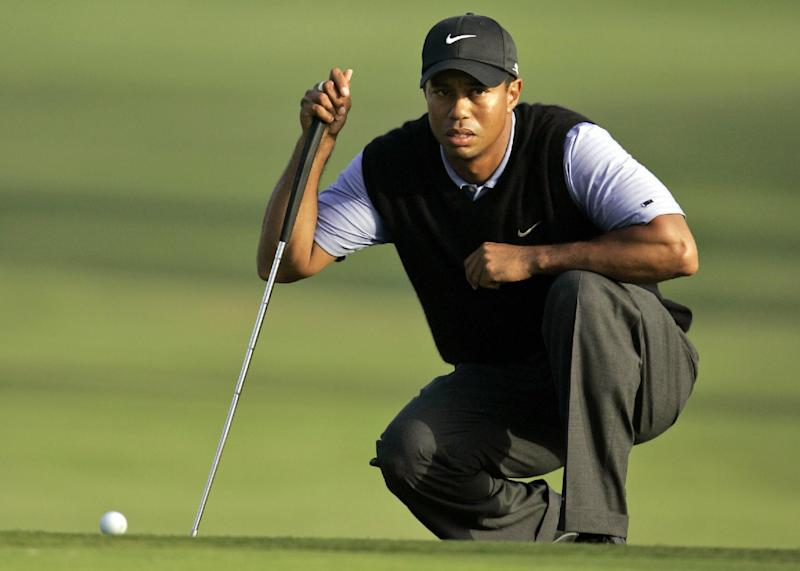FILE - In this June 14, 2008, file photo, Tiger Woods lines up his shot during the third round of the US Open championship at Torrey Pines Golf Course in San Diego. To try to gauge what kind of year Woods can expect, pay no attention to a missed cut in the Middle East. The better measure is Torrey Pines. It's one of five golf courses that account for more than 40 percent of his PGA Tour wins. (AP Photo/Charlie Riedel, File)