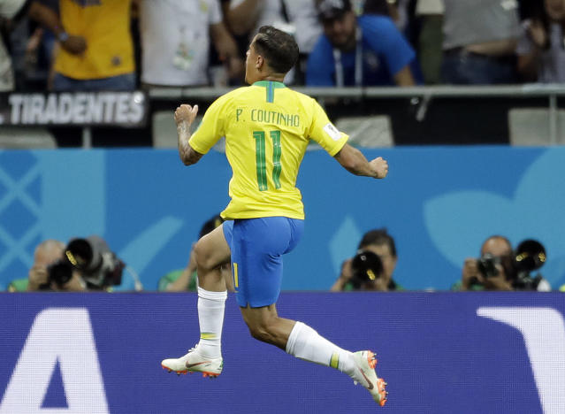 Brazil's Philippe Coutinho celebrates after scoring his side's first goal during the group E match between Brazil and Switzerland at the 2018 soccer World Cup in the Rostov Arena in Rostov-on-Don, Russia, Sunday, June 17, 2018. (AP Photo/Felipe Dana)