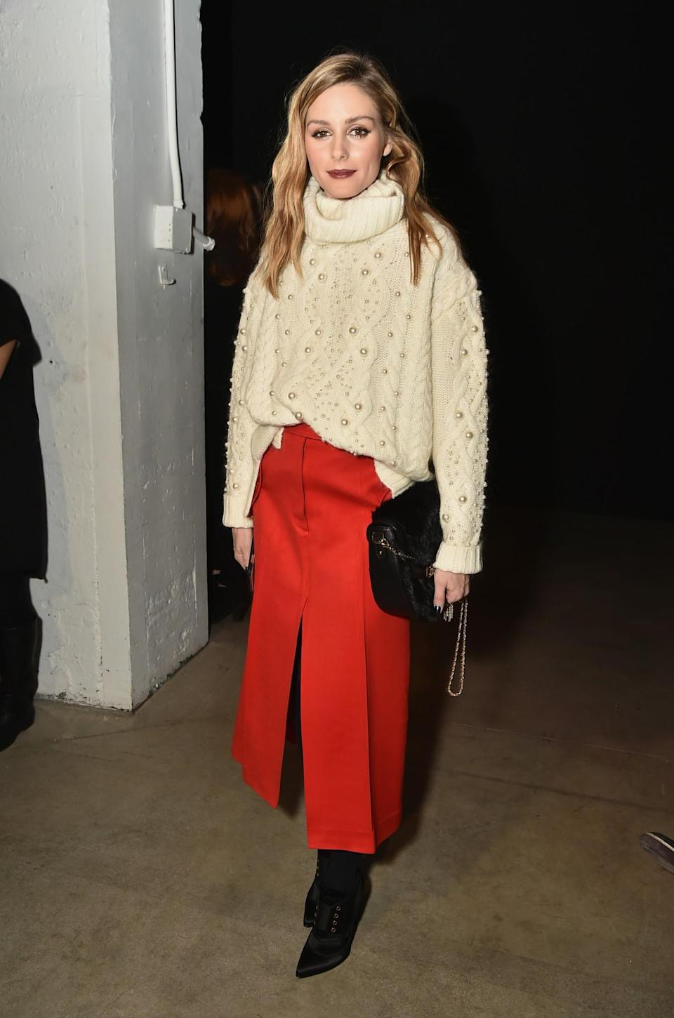 <p>Olivia Palermo chose a chunky knit and vibrant red skirt. <i>[Photo: Getty]</i> </p>