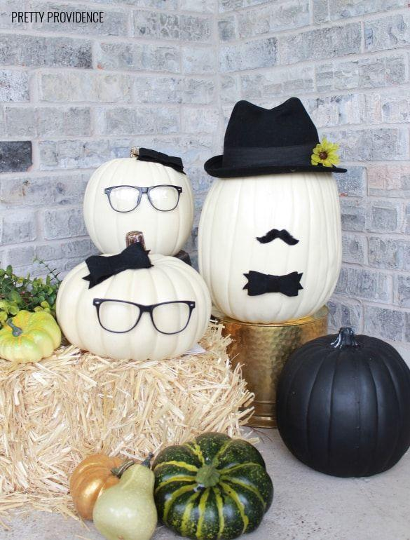 """<p>Use your family and friends as inspiration to create a gaggle of pumpkin faces! <br></p><p><strong>Get the tutorial at <a href=""""https://prettyprovidence.com/no-carve-pumpkin-people/"""" rel=""""nofollow noopener"""" target=""""_blank"""" data-ylk=""""slk:Pretty Providence"""" class=""""link rapid-noclick-resp"""">Pretty Providence</a>.</strong> </p>"""