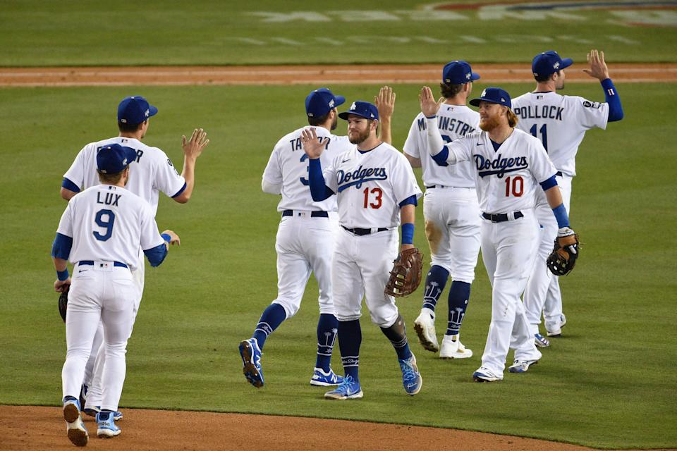 The Los Angeles Dodgers celebrate their 9-5 win against the Washington Nationals at Dodger Stadium on Saturday.