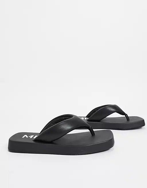 """<br><br><strong>Mango</strong> Mango Chunky Sole Flip Flop In Black, $, available at <a href=""""https://www.asos.com/mango/mango-chunky-sole-flip-flop-in-black/prd/23942640?colourwayid=60525420&SearchQuery=flip+flop+black"""" rel=""""nofollow noopener"""" target=""""_blank"""" data-ylk=""""slk:ASOS"""" class=""""link rapid-noclick-resp"""">ASOS</a>"""