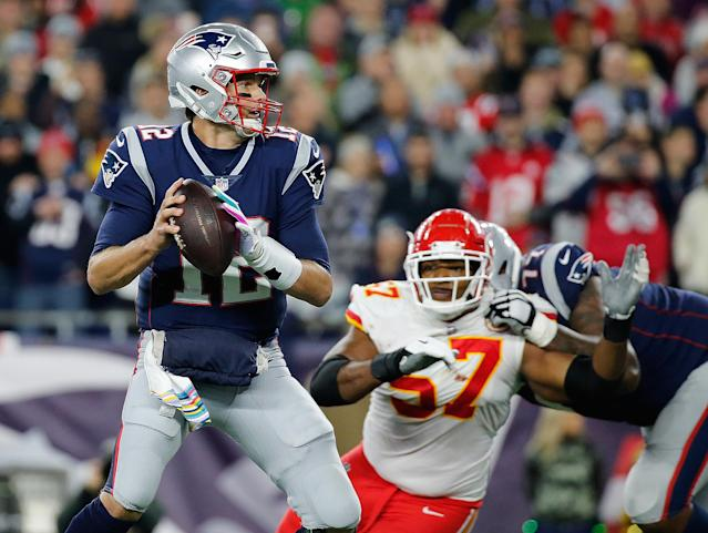 Tom Brady escaped the clutches of the Chiefs' Breeland Speaks to score a touchdown late on Sunday night. (Getty Images)