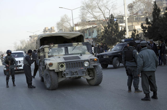 <p>Policemen block the road to the Intercontinental Hotel during a deadly attack in Kabul, Afghanistan, Jan. 21, 2018. (Photo: Massoud Hossaini/AP) </p>