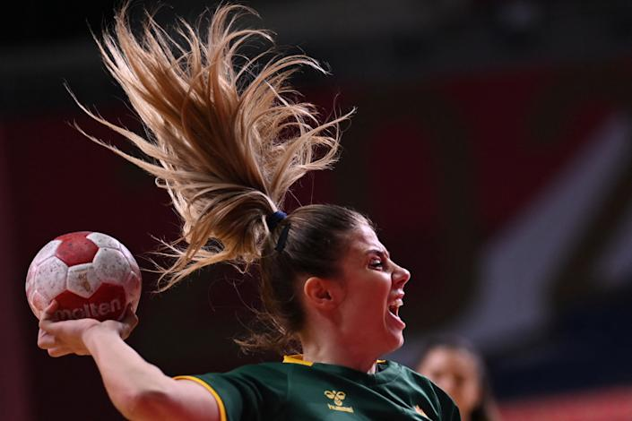 <p>Montenegro's centre back Matea Pletikosic shoots during the women's preliminary round group A handball match between Japan and Montenegro of the Tokyo 2020 Olympic Games at the Yoyogi National Stadium in Tokyo on July 27, 2021. (Photo by Daniel LEAL-OLIVAS / AFP)</p>