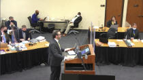 In this image taken from video, defense attorney Eric Nelson questions witness Los Angeles police department Sergeant Jody Stiger, as Hennepin County Judge Peter Cahill presides Wednesday, April 7, 2021, in the trial of former Minneapolis police Officer Derek Chauvin at the Hennepin County Courthouse in Minneapolis. Chauvin is charged in the May 25, 2020 death of George Floyd. (Court TV via AP, Pool)