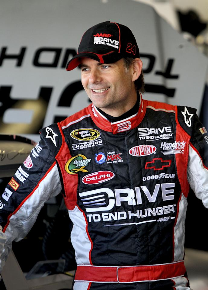 DAYTONA BEACH, FL - JANUARY 14:   Jeff Gordon, driver of the #24 Drive To End Hunger Chevrolet, stands in the garage area during Daytona Preseason Thunder at Daytona International Speedway on January 14, 2012 in Daytona Beach, Florida.  (Photo by Jerry Markland/Getty Images for NASCAR)