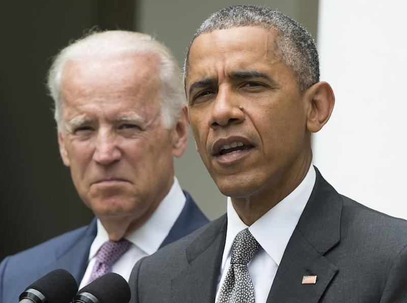 "US Vice President Joe Biden (L) reaffirmed to Japan a commitment by President Barack Obama (R) to focus US intelligence collection on ""national security interests"", the White House said (AFP Photo/Saul Loeb)"