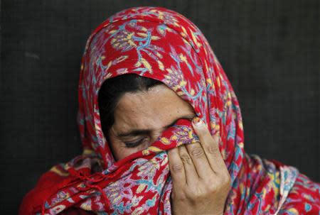 Saheema Akhtar, wife of Mohammed Amin Pandith, a village council head, who was killed by militants, weeps inside her house in Gulzarpora, south of Srinagar April 23, 2014. REUTERS/Danish Ismail