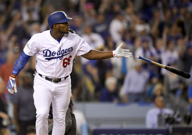 """<a class=""""link rapid-noclick-resp"""" href=""""/mlb/teams/lad/"""" data-ylk=""""slk:Los Angeles Dodgers"""">Los Angeles Dodgers</a>' <a class=""""link rapid-noclick-resp"""" href=""""/mlb/players/9341/"""" data-ylk=""""slk:Yasiel Puig"""">Yasiel Puig</a> watches his home run against the <a class=""""link rapid-noclick-resp"""" href=""""/mlb/teams/chc/"""" data-ylk=""""slk:Chicago Cubs"""">Chicago Cubs</a> during the seventh inning of Game 1 of baseball's National League Championship Series in Los Angeles, Saturday, Oct. 14, 2017. (AP)"""