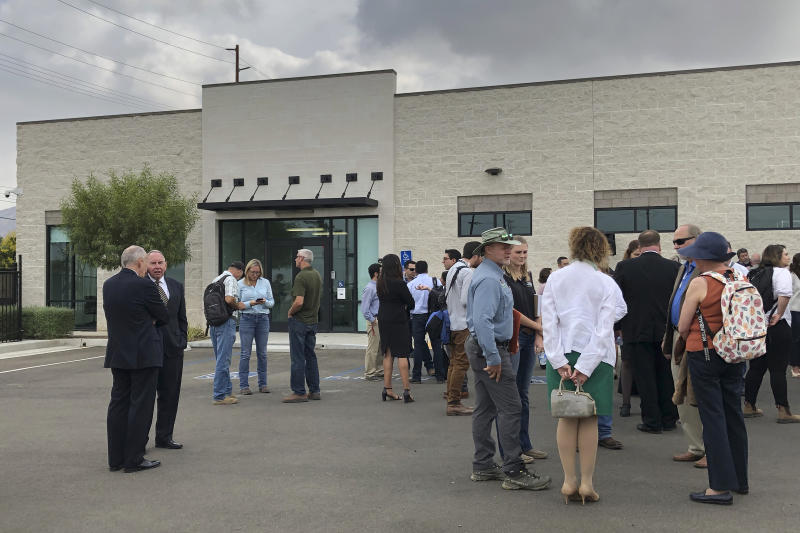 California citrus growers, packers and researchers gather for the opening of a new secure lab dedicated to the search for a cure for a deadly citrus-killing disease in Riverside, Calif., Thursday, Sept. 26, 2019. Growers hope the lab will speed up the search for a cure to the disease, which is spread by a tiny insect and has ravaged groves in Florida and abroad. The lab will be run through a partnership with University of California, Riverside. (AP Photo/Amy Taxin)